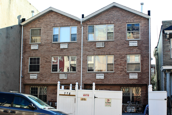 The real estate bust has resulted in the conversion of many recently constructed buildings into rooming houses, including this one in East New York.