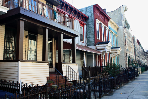 Several three-quarter houses occupy a single block of MacDonough Street in Bedford-Stuyvesant. (Some buildings pictured are not three-quarters houses.) The owner of one four-story house has been fined multiple times for building violations.