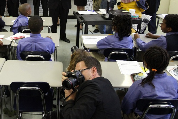 Photographers embed among schoolkids at a visit by then-Mayor Bloomberg and U.S. Education Secretary Arne Duncan to the Kings Collegiate Charter School in 2010. While NYC charter schools are often funded--and lobbied for--with corporate support, direct for-profit ownership is not permitted.
