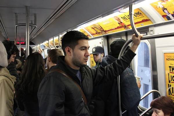 Ulysses Hernandez, a student at The New York Institute of Technology, rides the train from his home in Bushwick to school.