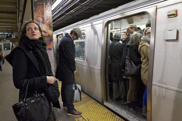 Commuters wait as the L-train arrives at the Bedford stop. A Brooklynite is 20 times more likely than the average American to take mass transit to get to work.
