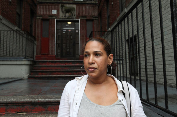 Cinthia Caimares, who has lived at 2500 University Avenue -- a Milbank property -- for about 2 years, is a student at Bronx Community College and works at Yankee Stadium on the weekends. She is afraid of being forced to move out and does not understand who owns the building.