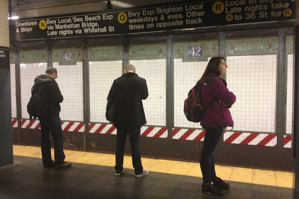 Grand central: Subway riders stand behind the yellow line while they wait for the next southbound N or Q train.