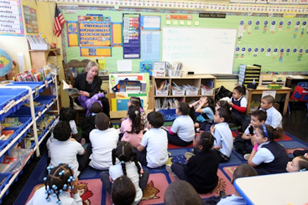 Chancellor-designate Cathie Black reads to a class at PS 109 in the Bronx.