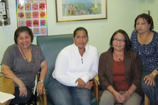 (From L to R) Celeste Garcia, Arelis Melo, Maria Contreras and Juana Hidalgo, workers at La Familia Unida day care center, in their staff room in Washington Heights.