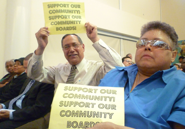 Bronx Community Board 2 district manager John Robert and member Joyce Campbell-Culler flash their feelings at Tuesday's hearing.