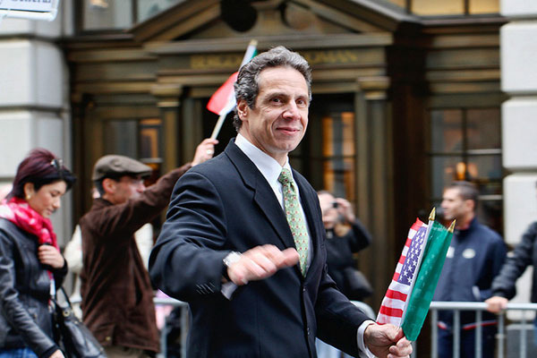 Cuomo marches in 2009 Columbus Day Parade. His bid for governor is unchallenged in Tuesday's primary election and he is well ahead in surveys of the general election.