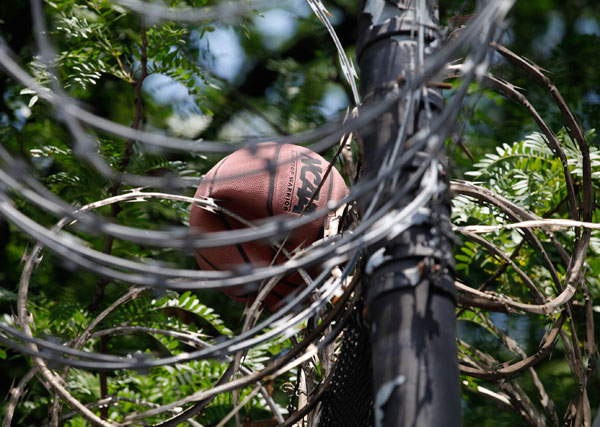 Barbed wire at Bridges Juvenile Facility in the Bronx traps a basketball.
