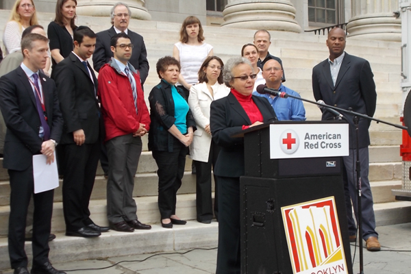 BCF President Marilyn Gelber announces the Red Cross grant outside Brooklyn's Borough Ball.