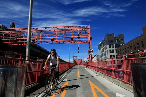 A cyclist crosses the Williamsburg Bridge. A New York City Department of Health survey conducted in 2010 found there to be modest differences among income groups when it comes to cycling: In the highest-income areas, 11.8 percent of people said they biked regularly, compared to 7.7 percent in the lowest-income areas.