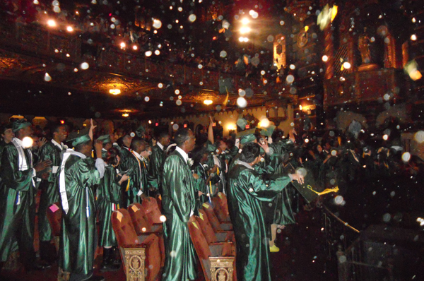 At their commencement ceremony in June, graduates at McKee Career and Technical High School toss their caps into the air. Principal Sharon Henry quoted a Japanese proverb, in saying that McKee grads