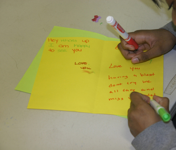 One of the children preparing to visit Albion prison prepares a card for her mother.