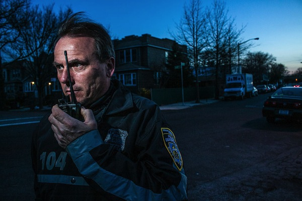 Frank A. Kotnick, Jr. president of the Glendale Civilian Patrol, gets a radio call while making his rounds one night in April. The Glendale group is one of several citizen anti-crime efforts that remain active.