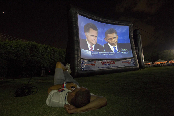 A member of the crowd watches Republican presidential nominee Mitt Romney and President Barack Obama meet in the final U.S. presidential debate in Boca Raton.