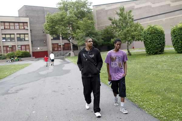 Junior Jeremy Lock, 18 (dressed in black) and freshman Patrick Green, 16, leaving Dewey High School in Brooklyn on Friday, June 22. Greene, who studies audiovisuals, produced a video called <a href=