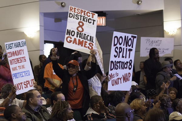 Protesters at an October hearing on proposed changes to City Council districts voice their concerns over redrawn lines for the East Harlem district represented by Melissa Mark-Viverito. A revised proposal is now under consideration.