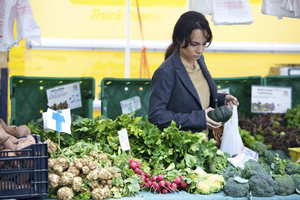 A shopper at the Bowling Green farmer's market. New York State is home to more than 36,000 farms—most of which are small, family farms ranging from one to 99-acres—that generate $5 billion in annual revenue.