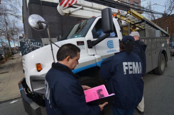 FEMA workers in Red Hook on December 11.