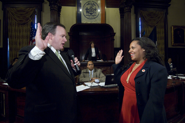 Queens Councilwoman Julissa Ferreras, right, seen getting sworn in to the body back in 2009. One of six Councilmembers facing no opposition on November 5, she also faced no primary challenge this year and no general election opponent in 2009.