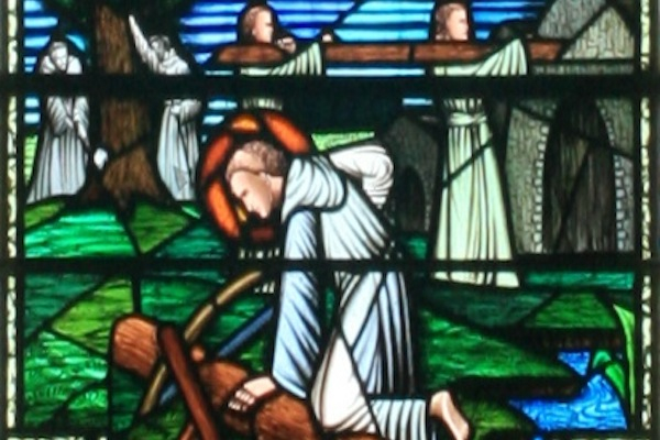 A stained-glass image depicts St. Finian and his followers constructing the abbey at Clonard.