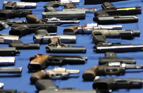 Guns displayed at an NYPD press conference. New York City has some of the toughest gun restrictions in the country, but they are undermined by lax regulations in other states.