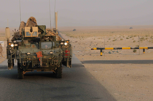 An Army unit crosses from Iraq into Kuwait on August 15 as part of the draw-down that has removed combat units but left some 50,000 U.S. servicemembers in Iraq.