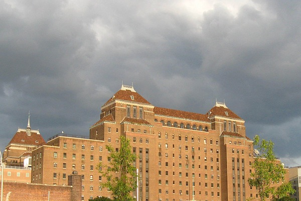Storm clouds gather over Kings County Hospital Center, a public hospital. While the Health & Hospital Corporation that runs New York City's public hospital system faces its own challenges, other nonprofit hospitals are threatened with closure or merger.