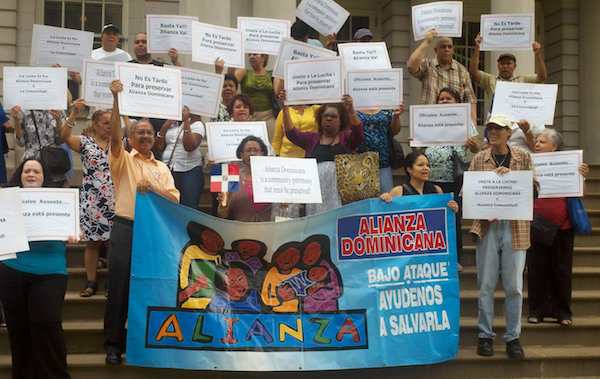 A protest in support of Alianza Dominicana, which has struggled amid financial management and a city investigation.