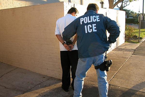 An ICE agent making an arrest.