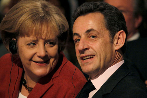 German Chancellor Angela Merkel and French President Nicolas Sarkozy probably aren't thinking about New York City's budget as they try to save the Euro, but a new report indicates the city will feel the effects if they fail.