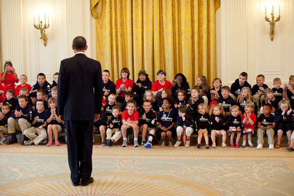 President Barack Obama talks with kids from the Children's Miracle Network in the East Room of the White House, June 9, 2010.