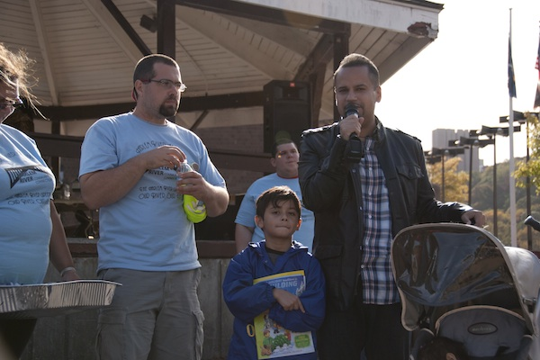 State Sen. Jose Serrano speaks at a recent event with his son at his side.