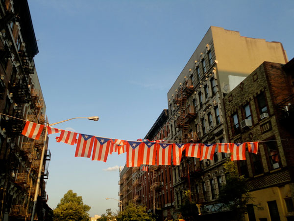 Puerto Rican flags strung across a street in South Williamsburg