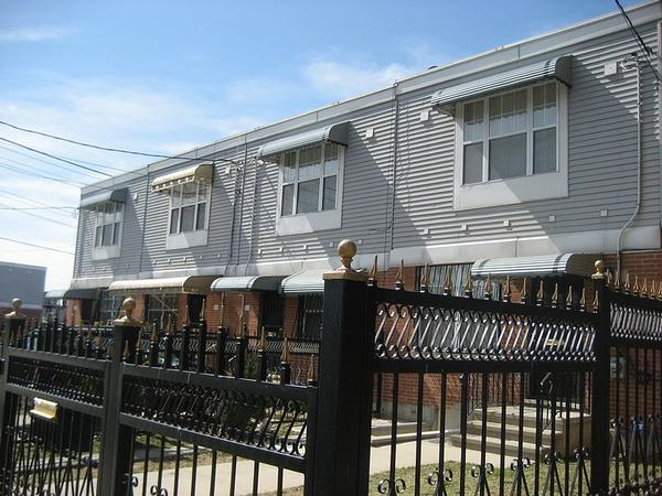 Homes on created by the Nehemiah Program along Snediker Avenue in East New York. Nehemiah and other efforts aimed at and often led by low- and moderate-income residents helped stabilize the area. Now some wonder if gentrification will price those residents out.