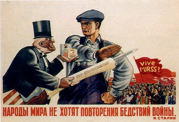 A Soviet propaganda poster from the immediate post-World War II era. In it, a Russian worker resists the lure of consumer luxuries offered by a Western mogul, who is also offering the NATO alliance (that's the document hiding the bayonet-tipped rifle). The quote at the bottom is from Stalin: