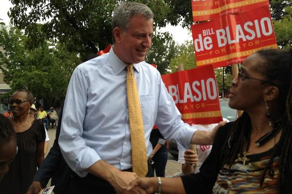 Democratic mayoral candidate Bill de Blasio shakes hands with supporter Gail Badger, assistant general manager of Co-op City's management company, Marion Scott Real Estate.