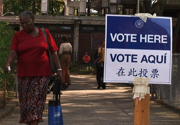 Voters heading to and fro the polling place at the Van Dyke Senior Center on Dumont Street in Brooklyn.