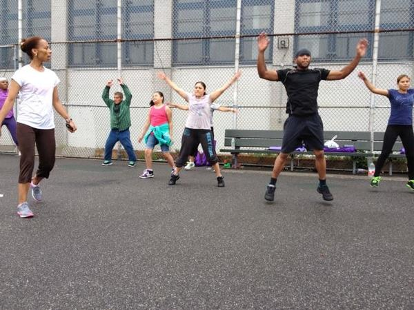 Yvanna Nazaire leads her aerobics class in jumping jacks on a Saturday morning in Bushwick. Her class is part of a Beacon program at IS-291.