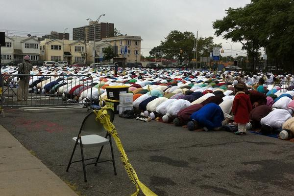 Muslim men, mainly Bangladeshis, observed the end of Ramadan, or Eid, in an East New York parking lot.