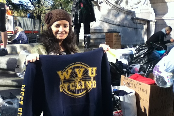 Enybe Merritt, 32, donates to Sandy victims gear she was going to ditch at the starting line of the cancelled Marathon.