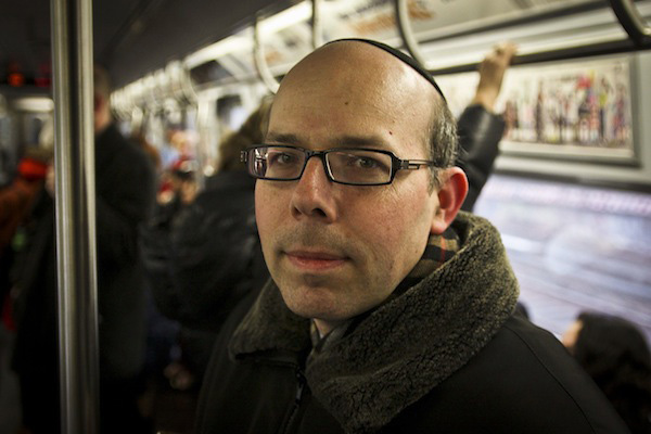 Abe Leitner rides the Q train from Brooklyn into Manhattan on Wednesday morning.