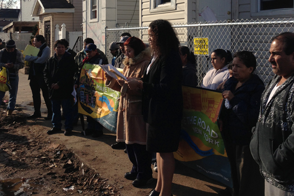 Undocumented immigrants in Staten Island protest a lack of assistance in the wake of superstorm Sandy. Second from right, holding the sign, is Maria Raquel.