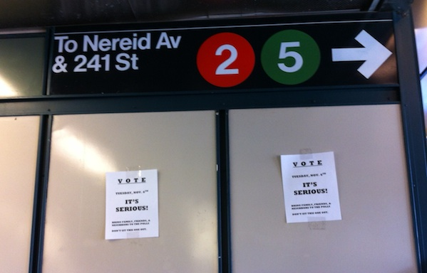 Home printed signs at the Gun Hill Road subway stop in the Bronx.