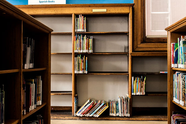 Nearly empty shelves at the Mott Haven branch in the Bronx. While patrons can order books from anywhere in the system, some users say they miss the ability to peruse the stacks.