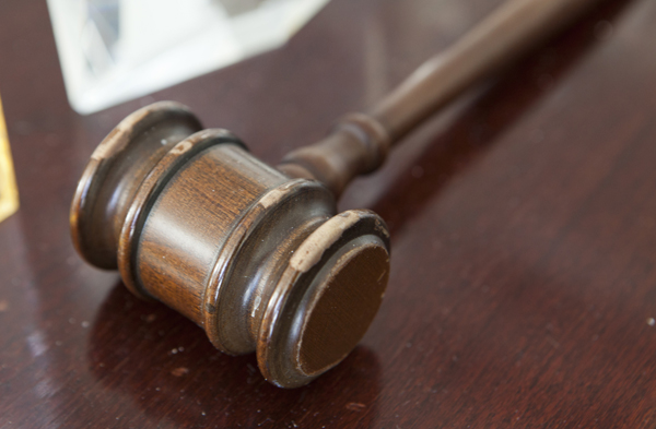 A family court judge's gavel. While recent law and policy have pressed for action to end long-term foster care arrangements, sometimes inaction—as in the case of a client for whom remaining in foster care was preferable to acknowledging that her birth family was no longer her own—is what a client wants, and, maybe, needs.
