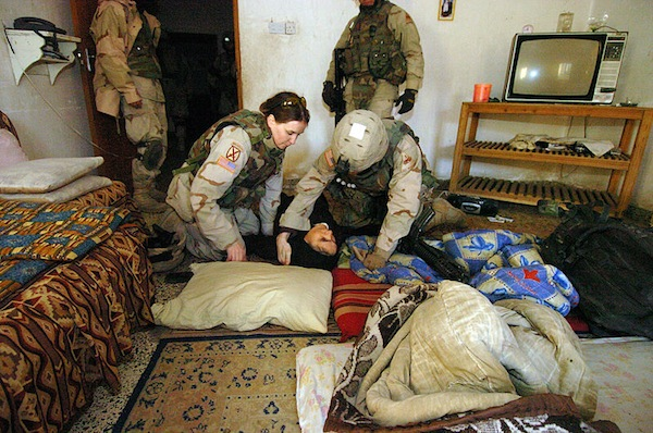 A female U.S. soldier provides first aid to an Iraqi civilian. According to the DOD, some 15 percent of active duty and reserve soldiers, sailors, Marines and Coast Guard and Air Force members are women. According to the GAO, the number of women who end up homeless after leaving the service more than doubled from 2006 to 2010.