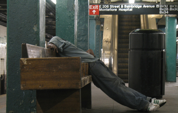 A man sleeps in the Norwood D-train station in 2010. (File)