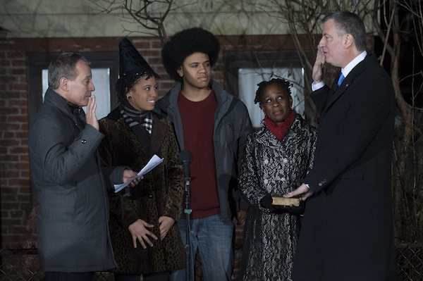 De Blasio is sworn in just after midnight on January 1.