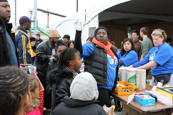 In the aftermath of Hurricane Sandy, volunteer efforts have sometimes been more visible than official government recovery work. From feeding the hungry to treating the sick to doing clean-up work in flooded houses, neighborhood groups and grassroots collectives have coordinated a multifaceted response to the storm.  At left, teachers from central Brooklyn pass out batteries and other supplies to Coney Islanders in the MCU Park parking lot.