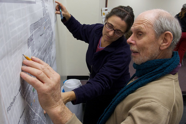 Michael Carder & Susannah Laskaris identify park space on a map at a recent participatory budgeting meeting in Brooklyn's 45th Council district, one of four where a pilot project is under way to allow constituents to decide how some capital funding is spent.